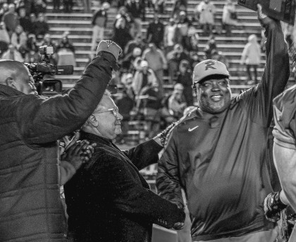 State Sen. Rodger Smitherman, D-Birmingham, and interim Birmingham School Superintendent Larry Contri congratulate Ramsay coach Reuben Nelson after his Rams beat Austin 24-14 to win their Class 6A Alabama High School Athletic Association semifinal on Frid